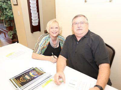 Debbie and Paul Walls volunteering as registrators