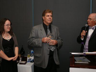 Georgia Shea, ASL Founder Eddie Beaudin with Lifetime Appreciation Award and M/C Rick Marchoke