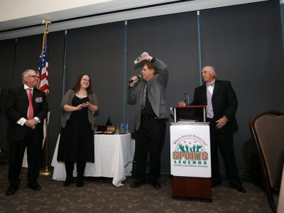 ASL Founder Eddie Beaudin showing Lifetime Appreication Achievement award over head