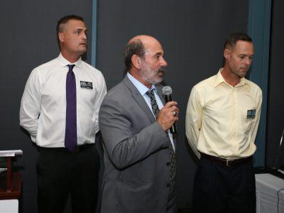1995 Boys Volleyball Head Coach Lou Panzella with team members, Larry Lentz ll and Jonathan Tiernan