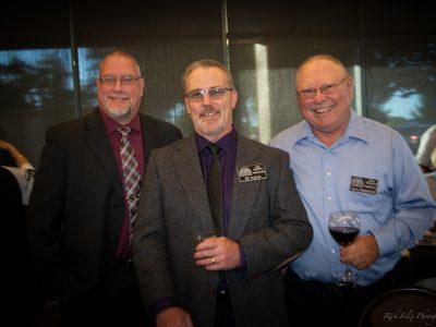 Enjoying Social Hour are Team Inductee 2016 Glenn Davis, 2016 Inductee Bill Dupree and 2009 Inductee Larry Hopwood