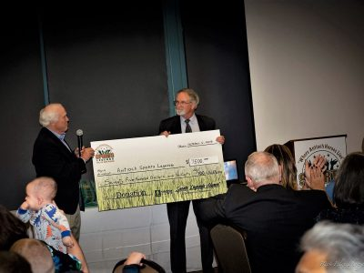 Steve Parks presenting the Alumni check to Tom Lamothe
