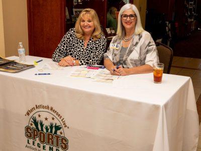 Antioch Sports Legends Founder Eddie Beaudin's wife, Dorothy Beaudin and Antioch Sports Legends Super Volunteer Kris Delmonte at the registration table.
