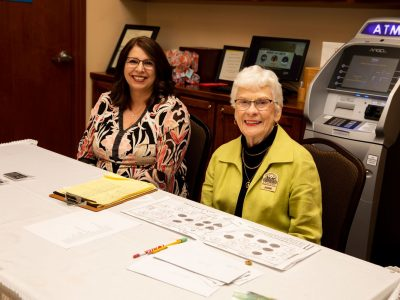 ASL Volunteer Florene Bras and Ticket Chair Joanne Bilbo at registration table.