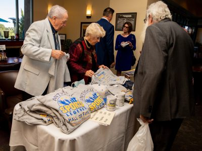 John and Barbara Harris at the Appreal Merchandise Table