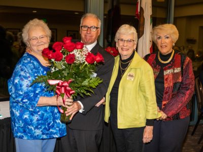 On behalf of the Antioch Sports Legends, Gary Bras presents roses of apprecation to volunteers Sherill Hecock, Joanne Bilbo and Barbara Harris.